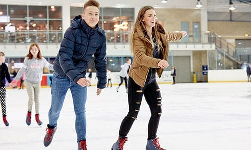 young confident skaters on ice
